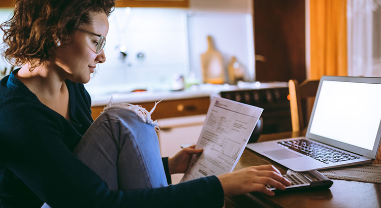 Woman going through bills at home
