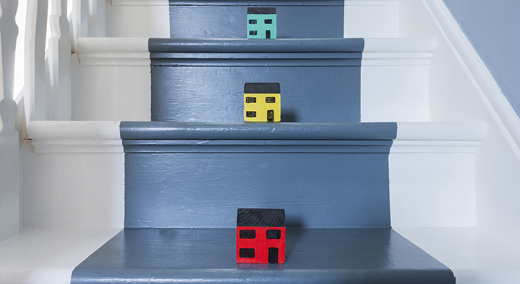 Scale model houses on a traditional domestic staircase