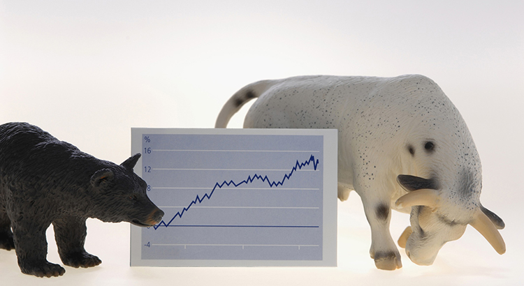 Bull and bear sculptures beside line graph, close up